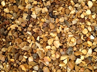 Golden Gravel (flint) 10mm. usual depth 30 to 40mm. Dutton Builders Merchants Ltd Product image
